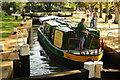 SU9949 : Narrowboat in Millmead Lock, Guildford, Surrey by Peter Trimming