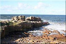 NJ1570 : A Sunday rambler rests by Daisy Rock by Des Colhoun