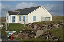 HU4841 : Bressay Heritage Centre with relocated burnt mound from Cruester by john bateson