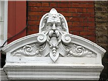 TQ2881 : Hirsute man on a building in Chiltern Street, W1 by Mike Quinn