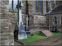 J4844 : More clerical graves at St Patrick's RC Church, Downpatrick by Eric Jones