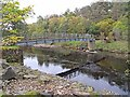 NY6761 : Footbridge over the South Tyne by Oliver Dixon