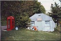 SX5646 : Stoke Beach Social Club and telephone box, Devon by nick macneill