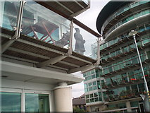 TQ3480 : Mandarin figure on balcony by Paul Gillett