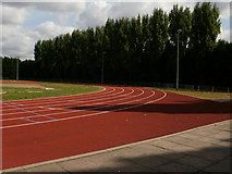 TQ2472 : Athletics track by Peter S