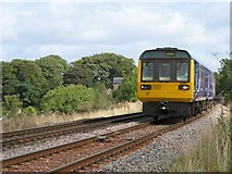 NY6366 : Newcastle to Carlisle train passing Milecastle 48 by Mike Quinn