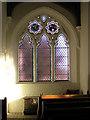 TM1085 : St Mary's church - south aisle east window by Evelyn Simak