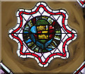 TM1085 : St Mary's church - medieval glass in south aisle east window by Evelyn Simak