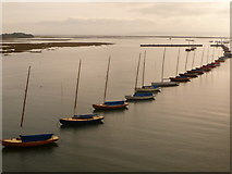 SZ3394 : Lymington: boats lining the harbour channel by Chris Downer