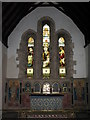 NZ0461 : Bywell St. Andrew - altar, Victorian reredos, and chancel east end windows by Mike Quinn