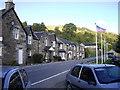 NN8160 : Flags outside Loch Tummel Inn by PAUL FARMER