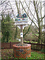 TM2384 : Starston village sign by the bridge over the Beck by Evelyn Simak