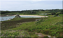 SV9210 : Porth Hellick and the Loaded Camel rock, St Mary's, Scilly by John Rostron