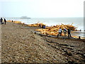 TQ1402 : Worthing Beach covered in planks of wood by nick macneill