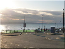 SZ1191 : Boscombe: green netting along the prom railings by Chris Downer