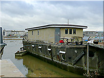 TQ2104 : Concrete hulled houseboat, Shoreham Beach, West Sussex by Roger  Kidd