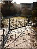 SZ0891 : Bournemouth Gardens: a gate and its shadow by Chris Downer