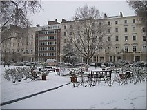 TQ2978 : Frozen Fountain in St George's Square by PAUL FARMER