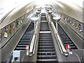 TQ2570 : Escalators at South Wimbledon station by Stephen Craven
