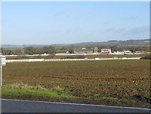 TR1236 : Folkestone racecourse from the A20 Ashford Road by Nick Smith