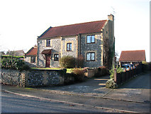 TL8786 : House in the Street, Croxton by Evelyn Simak