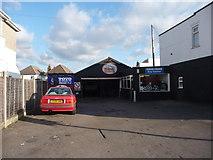 SZ0995 : Bournemouth : Moordown - Mike Stokes Motoring Garage by Lewis Clarke