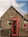 SY9681 : Corfe Castle: postbox № BH20 125 and phone, East Street by Chris Downer