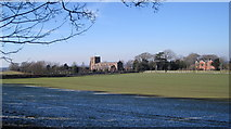 NY3767 : Arthuret church from Woodland Edge by Andy Connor