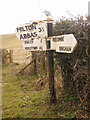 ST7700 : Cheselbourne: damaged signpost at the Milton Abbas turn by Chris Downer