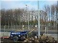 O1743 : View across roadworks to Hangar 6 at Dublin Airport by Eric Jones