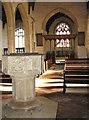TL9991 : All Saints church in Snetterton - C15 baptismal font by Evelyn Simak