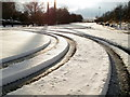 SK4191 : Vehicle tracks in snow by Nic Franklin-Woolley