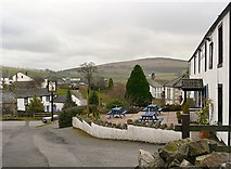 NY2436 : View of Uldale from the Snooty Fox by Rose and Trev Clough