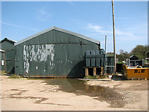 TM4599 : Boatyard sheds beside the River Waveney in St Olaves by Evelyn Simak