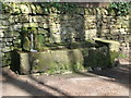 NY9964 : Water trough in Spoutwell Lane by Mike Quinn