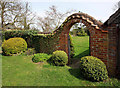 TF9624 : Archway to garden by John Salmon