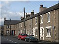 NY9864 : Terraced houses, Watling Street by Mike Quinn