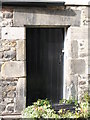 NY9864 : Old doorway in the yard at the Wheatsheaf Hotel by Mike Quinn