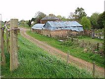 TF5902 : Farm buildings by Downham Bridge by Evelyn Simak