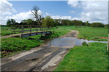 TF2385 : Ford and Footbridge on the River Bain at Biscathorpe by John Walton
