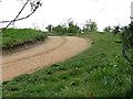 TF6918 : Farm track past All Saints church, Ashwicken by Evelyn Simak