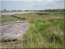 TR0262 : An old jetty and old boats at Faversham Creek by Marathon