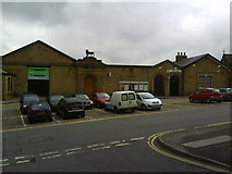 SK0394 : Glossop Railway Station and The Co-Operative by Benjamin Hopkins
