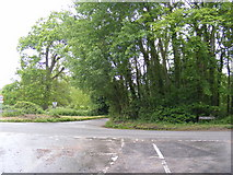 TG1407 : Approaching the B1108 Watton Road Crossroads on New Road by Adrian Cable