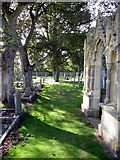 TA1181 : St Oswald's, Filey - churchyard by John S Turner