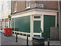 TQ8209 : Shuttered Shop on George Street by Oast House Archive