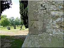 TF7928 : Bench Mark at New Houghton church by Adrian S Pye