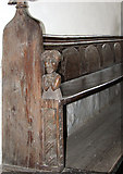 TF7928 : St Martin's church in Houghton - C17 bench by Evelyn Simak