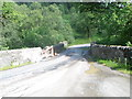 NN1905 : Damaged bridge on the B839 over the River Goil by John Ferguson
