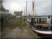 TR0262 : Saxon Shore Way passing through a boatyard at Faversham by Marathon